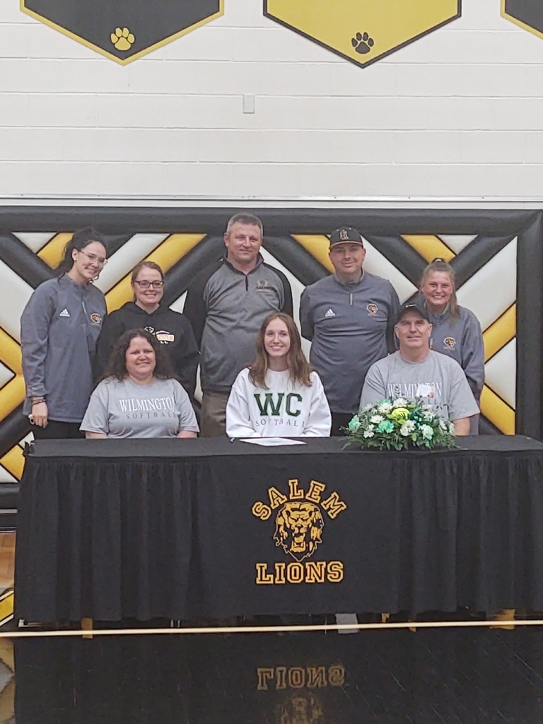 Bailey with her parents and coaching staff
